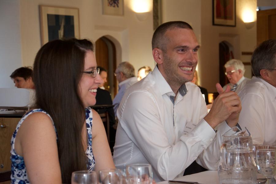 Members sharing a joke at a Cambridge 100 dinner